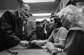 George Best, book signing London 1981 with his wife Angie. Where Do I Go from Here?: An Autobiography by George Best and Geoffrey Wright - Martin Mayer - 1980s,1981,ACE,Angie Best,author,authors,autobiography,Biography,book,book signing,books,book-signing,celebrities,celebrity,Culture,football,footballer,Geoge Best,interacting,interaction,launch,London