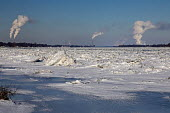 Marine City, Michigan, USA: DTE Energy coal and oil fired power stations line the US side (L) of the ice filled St. Clair River - Jim West - 01-02-2019