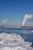 Marine City, Michigan, USA: Coal and oil fired power stations and chemical plants line the ice filled St. Clair River - Jim West - 2010s,2019,Air Pollution,Air Quality,America,Blue Sky,border,C02 Emissions,CAN124,Canada,Climate Change,coal fired,cold,Detroit Edison,DTE Energy,EBF,Economic,Economy,ELECTRICAL,electricity,emissions,