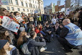Climate strike students blocking the roads around Parliament Square, Westminster, London. - Jess Hurd - 7,action,activist,activists,adolescence,adolescent,adolescents,adult,adults,against,argue,arguing,argument,block,blockade,blockading,blocking,blocks,CAMPAIGN,campaigner,campaigners,CAMPAIGNING,CAMPAIG