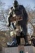 Climate strike students on Churchill statue, Parliament Square, Westminster, London. - Jess Hurd - action,activist,activists,adolescence,adolescent,adolescents,against,blocking,CAMPAIGN,campaigner,campaigners,CAMPAIGNING,CAMPAIGNS,child,CHILDHOOD,children,Churchill,climate,Climate Change,DEMONSTRAT