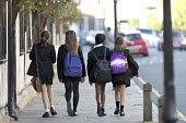 Grammar School pupils walking to school, KES, Stratford-upon-Avon - John Harris - backpack,backpacks,bag,bags,BAME,BAMEs,BEMM,BEMMs,Black and White,BME,bmes,child,CHILDHOOD,children,diversity,ethnicity,female,females,girl,girls,Grammar School,juvenile,juveniles,KES,kid,kids,King Ed