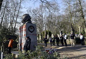 Marx Memorial vandalised, Highgate Cemetery, London. Visitors to Highgate Cemetery looking on at the memorial to Karl Marx after its initial cleaning to remove the worst of the graffiti that besmirche... - Stefano Cagnoni - 17-02-2019