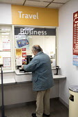 Post office in WH Smiths, Kingswood, Bristol - Paul Box - 2010s,2019,age,ageing population,buying,commodities,commodity,consumer,consumers,counter,counters,customer,customers,EBF,Economic,Economy,elderly,employee,employees,Employment,job,jobs,LBR,MAIL,male,m