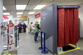 Post office in WH Smiths, Kingswood, Bristol - Paul Box - 2010s,2019,booth,booths,buying,commodities,commodity,consumer,consumers,counters,customer,customers,device,devices,digital,driving licence,DVLC,EBF,Economic,Economy,equipment,machine,machinery,machine