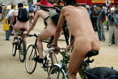 World Naked Bike Ride. Cyclists for an Oil Free Future ride naked in London to protest against oil dependency and the destructive effects of car culture. Part of London Sustainability Week 2005, and N... - Jess Hurd - 11-06-2005
