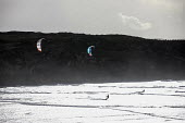 Kitesurfers surfing, Amoreira, Algarve, Portugal - Paul Box - 2010s,2018,activities,COAST,Extreme Sports,hobbies,hobby,hobbyist,holiday,holiday maker,holiday makers,holidaymaker,holidaymakers,holidays,kite,kites,Kitesurfer,Kitesurfers,Kitesurfing,Leisure,LFL,LIF