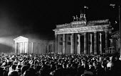 Celebrating the fall of the Berlin Wall, New Year's Eve 1989, The Brandenburg Gate by the Berlin Wall, Germany. The first joint East German West German New Years Eve party - Melanie Friend - 31-12-1989