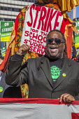 Oakland, California, USA: Teachers strike protest for smaller class sizes, more resources and higher pay. OEA President Keith Brown leading the march - David Bacon - 2010s,2019,activist,activists,African American,African Americans,against,BAME,BAMEs,banner,banners,black,BME,bmes,California,CAMPAIGNING,CAMPAIGNS,charter schools,DEMONSTRATING,demonstration,dispute,d