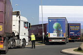 Worker directing lorries waiting to enter B&Q RCC distribution centre, Swindon - John Harris - 25-02-2019