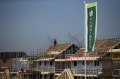 Persimmon housebuilding, Wellesbourne, Warwickshire. Persimmon enjoyed a 31% operating profit margin subsidised by the help-to-buy scheme - John Harris - 2010s,2019,banner,banners,builder,builders,building,building site,buildings,capitalism,Construction Industry,EBF,Economic,Economy,greenbelt,greenfield,house,house building,housebuilder,housebuilders,h