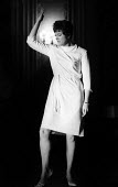 Jazz singer Annie Ross performing in a West End nightclub London 1961 - Romano Cagnoni - 1960s,1961,ACE,Annabelle Allan Short,Annie Ross,Arts,cities,City,club,clubs,Culture,entertainment,FEMALE,jazz,London,melody,modern,modernism,modernist,modernists,music,MUSICAL,musician,musicians,night