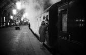 Couple saying goodbye Kings Cross Station London 1961 as late night steam train prepares to leave - Romano Cagnoni - 13-09-1961