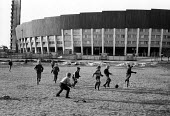 Finland 1963 Newly housing blocks designed by architect Aarne Ervi and built in the post war reconstruction plan. Boys playing football using jumpers for goal posts - Romano Cagnoni - 06-06-1963