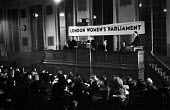 London Women's Parliament meeting,1947, debating price increases and inflation affecting British households - Felix H. Man - 1940s,1947,Central Hall,cities,City,cost of living,DEBATE,debating,FEMALE,figures,finance,FINANCIAL,food prices,household goods,inflation,London,London Womens Parliament 1947,London Women's Parliament