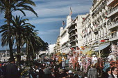 Crowd watching the annual Nice Carnival France 1948 as it moves along the Promenade d'Anglais - Felix H. Man - 08-02-1948