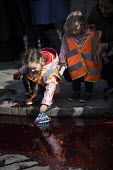 Extinction Rebellion protest, activists throwing fake blood outside Downing Street to highlight climate change, Westminster, London - Jess Hurd - 2010s,2019,activist,activists,against,blood,CAMPAIGN,campaigner,campaigners,CAMPAIGNING,CAMPAIGNS,child,CHILDHOOD,children,cities,City,Climate Change,DEMONSTRATING,demonstration,DEMONSTRATIONS,Downing