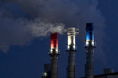 Dearborn, Michigan USA: Red, white and blue chimneys, Dearborn Industrial Generation plant. Burning natural gas and waste blast furnace gas to produce electricity for the River Rouge complex and the m... - Jim West - 05-03-2019