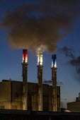 Dearborn, Michigan USA: Red, white and blue chimneys, Dearborn Industrial Generation plant. Burning natural gas and waste blast furnace gas to produce electricity for the River Rouge complex and the m... - Jim West - 2010s,2019,air pollution,american,americans,BURN,Burning,BURNS,capitalism,carbon monoxide,chimney,chimneys,climate change,CMS Energy,co2,dark,Dearborn Industrial Generation,EBF,Economic,Economy,ELECTR