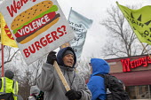 Ypsilanti, Michigan USA: Coalition of Immokalee Workers protest at a Wendy's fast food restaurant, asking the company to pay more for the Florida tomatoes to improve wages for Florida farmworkers, who... - Jim West - 09-03-2019