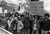 Libyan students protest, American Embassy, London 1983 at the aggressive stance of the USA to Libya - NLA - 1980s,1983,activist,activists,against,American,americans,Arab,CAMPAIGNING,CAMPAIGNS,Colonel Gaddafi,DEMONSTRATING,Demonstration,imperialism,Libya,Libyan,Libyans,London,male,man,men,people,person,perso