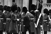 King Hussein of Jordan inspecting the Guard of Honour, Foreign Office, London 1983 during the visit by Arab heads of state - NLA - 1980s,1983,Arab,army,British Household Division,ceremonial,ceremonies,ceremony,Foreign,foreigner,foreigners,Guard,Guard of Honour,international,Jordan,King Hussein,London,male,man,men,middle east,mili