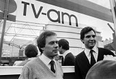 TV-am press re-launch, London, 1983 with Nick Owen (L) and Jonathan Aitken. The Breakfast television TV broadcaster - NLA - 1980s,1983,ACE,Breakfast,broadcaster,communicating,communication,CONSERVATIVE,Conservative Party,conservatives,Culture,EBF,Economic,Economy,host,Jonathan Aitken,London,male,man,men,MP,MPs,Nick Owen,pe