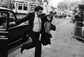 Detective Constable John Jardine arriving at court, London 1983 one of two policeman accused of the attempted murder of Stephen Waldorf after they had wrongly identified him. The policemen were acquit... - NLA - 1980s,1983,adult,adults,against,arrival,arrivals,arrive,arrives,arriving,cab,cabs,cas,CLJ,court,court case,courts,Crime,force,High Court,John Jardine,Justice,Law,London,male,man,men,Metropolitan Polic