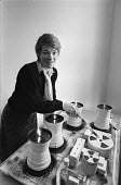 Glenda Jackson cutting anti nuclear cake London 1983; The cake is in the form of nuclear power station with a symbol - NLA - 1980s,1983,ACTING,activist,activists,actor,ACTORS,actress,against,anti,anti- nuclear,anti-nuclear cake,anti-nuclear protest,atomic,cake,campaigner,campaigners,communicating,communication,Cooling Tower