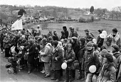 1983, 70,000 women protesters forming a 14 mile human chain 1983 between Greenham Common USAF American Airforce Base from which cruse missile launchers were deployed to Burghfield, Aldermaston nuclear... - Peter Arkell - peace movement,1980s,1983,activist,activists,against,Air force,Airbase,airbases,Airforce,American,americans,Anti War,Antiwar,armed forces,atomic,banner,banners,bomb,BOMBS,CAMPAIGN,Campaign for nuclear