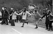 1983, 70,000 women protesters forming a 14 mile human chain 1983 between Greenham Common USAF American Airforce Base from which cruse missile launchers were deployed to Burghfield, Aldermaston nuclear... - Peter Arkell - peace movement,1980s,1983,activist,activists,against,age,ageing population,Air force,Airbase,airbases,Airforce,American,americans,Anti War,Antiwar,armed forces,atomic,banner,banners,bomb,BOMBS,CAMPAIG