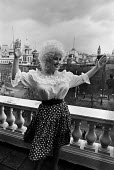 Dolly Parton, Carlton House Terrace, London, 1983, photocall to promote her concert at the Dominion Theatre - Peter Arkell - 1980s,1983,ACE,Arts,celebrities,celebrity,concert,CONCERTS,country music,Culture,Dolly Parton,Dominion Theatre,FEMALE,House,houses,London,melody,music,MUSICAL,musician,musicians,people,person,persons,