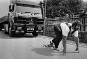 Geoff Capes pulling a 12.5 Ton lorry 1983, establishing a new world record in truck pulling, Crystal Palace Sports Centre, London. It took him 54.3 seconds to haul the Mercedes Benz tractor and trailo... - Peter Arkell - 10-08-1983