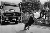 Geoff Capes pulling a 12.5 Ton lorry 1983, establishing a new world record in truck pulling, Crystal Palace Sports Centre, London. It took him 54.3 seconds to haul the Mercedes Benz tractor and trailo... - Peter Arkell - 1980s,1983,athlete,athletes,athletics,Britain's Strongest Man,Champion,Champions,COMPETITATIVE,competition,competitions,competitor,Extreme Sports,Games,Geoff Capes,HAULAGE,HAULIER,HAULIERS,heavy weigh