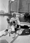 Gina Campbell, St. Katherine's dock London 1984, daughter of Donald Campbell publicising her attempt on the women's world water speed record (which she achieved). She is holding her father's mascot be... - Peter Arkell - 19-05-1984