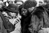Mother and family, funeral of Colin Roach 1983. He was shot inside the entrance to Stoke Newington police station, East London - Ray Rising - 18-02-1983