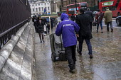 Westminster street cleaner in the rain, London - Jess Hurd - 2010s,2019,activist,activists,against,CAMPAIGN,campaigner,campaigners,CAMPAIGNING,CAMPAIGNS,cities,City,cleaner,cleaners,cleaning,cleansing,CLIMATE,conditions,DEMONSTRATING,Demonstration,DEMONSTRATION