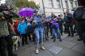 Pro EU campaigner is heckled, jeered and thrown money by UKIP supporters, outside Parliament during votes on how the UK leaves the European Union, Westminster, London. Sheffield musician Madeleina Kay - Jess Hurd - 14-03-2019