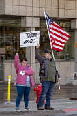 Detroit, Michigan, USA: We Build the Wall Rally to promote construction of a Mexican border wall. Flag and a Trump 2020 sign outside - Jim West - 2010s,2019,America,american,americans,barrier,bigotry,border,border control,border controls,border fence,border wall,borders,build the wall,DEMOCRACY,Detroit,Diaspora,DISCRIMINATION,Donald Trump,elect