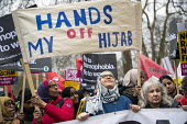 Stand Up to Racism march and rally, London. UN Anti Racism Day, Hands of My Hijab banner - Jess Hurd - 2010s,2019,activist,activists,against,Anti Racism,anti racist,BAME,BAMEs,banner,banners,bigotry,Black,Black and White,BME,bmes,CAMPAIGNING,CAMPAIGNS,DEMONSTRATING,Demonstration,DEMONSTRATIONS,DISCRIMI