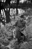 Artist John Nash 1958 very happy with his catch whilst pike fishing beside the River Stour near his home in Wormingford Essex - Kurt Hutton - 24-06-1958