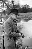 Artist John Nash 1958 pike fishing in the River Stour near his home, Wormingford Essex - Kurt Hutton - 24-06-1958