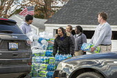 Flint, Michigan USA: World Water Day volunteers distributing 12 truckloads of bottled. The water supply was contaminated with lead nearly five years ago - Jim West - 22-03-2019