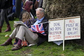 People's Vote march, London. For a second EU referendum. Doing the crossword - Philip Wolmuth - 23-03-2019