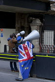 Steve Bray anti Brexit protestor shouting No Brexit! down a megaphone, Parliament, Westminster, London he is known as Mr. Stop Brexit - David Mansell - 2010s,2019,activist,activists,against,Brexit,camera,cameras,CAMPAIGNING,CAMPAIGNS,costume,costumes,DEMONSTRATING,Demonstration,dressed up,dressing up,employee,employees,Employment,equipment,EU,Europea
