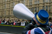 Steve Bray anti Brexit protestor shouting No Brexit! down a megaphone, Parliament, Westminster, London he is known as Mr. Stop Brexit - David Mansell - 2010s,2019,activist,activists,against,Brexit,CAMPAIGNING,CAMPAIGNS,costume,costumes,DEMONSTRATING,Demonstration,dressed up,dressing up,EU,European Union,fancy dress,flag,flags,hat,hats,Houses of Parli
