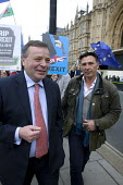 Arron Banks (L) co-founder of the  Leave.EU campaign and Andy Wigmore (R) walking through Remain anti Brexit protest opposite the Houses of Parliament, Westminster, London - David Mansell - 2010s,2019,activist,activists,AFFLUENCE,AFFLUENT,against,Bourgeoisie,Brexit,businessman,businessmen,CAMPAIGNING,CAMPAIGNS,DEMONSTRATING,Demonstration,donor,donors,elite,elitism,EU,European Union,high,