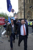 Arron Banks (R) co-founder of the  Leave.EU campaign and Andy Wigmore (L) walking through Remain anti Brexit protest opposite the Houses of Parliament, Westminster, London - David Mansell - 27-03-2019