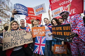 Conservative leave supporters at Pro Brexit protests on the day the UK was meant to leave the EU, Westminster, London - Jess Hurd - 2010s,2019,activist,activists,against,BAME,BAMEs,Black,Black and White,BME,bmes,Brexit,CAMPAIGNING,CAMPAIGNS,DEMONSTRATING,demonstration,diversity,ethnic,ethnicity,EU,European Union,flag,flags,leave,L