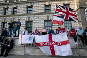 Pro Brexit protests on the day the UK was meant to leave the EU, Westminster, London. Democratic Football Lads Alliance - David Mansell - 2010s,2019,Brexit,campaign,campaigning,CAMPAIGNS,EU,European Union,Far Right,Far Right,flag,flags,Football,Leave,London,nationalism,parliament,rightwing,St George's flag,Union Jack,Westminster